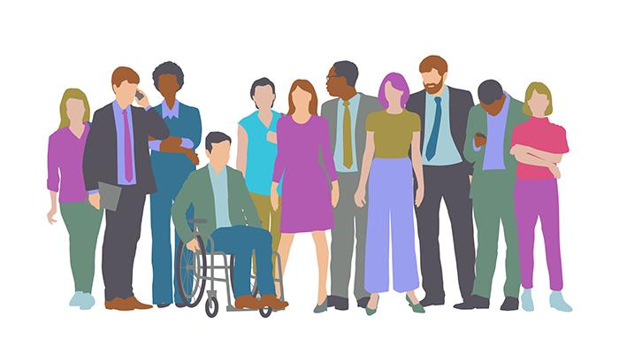Mies pyörätuolissa ja joukko miehiä ja naisia seisomassa ympärillä.